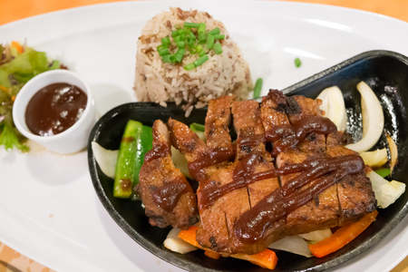 BBQ Pork Steak with vegetable, rice and pepper sauce photo
