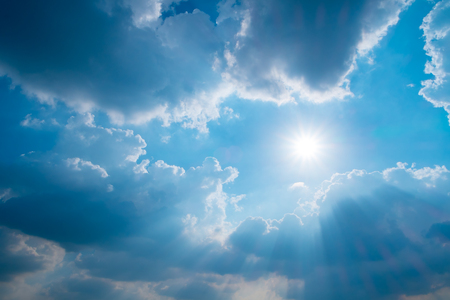 Blue sky with sun, sunbeams and clouds, Nature background