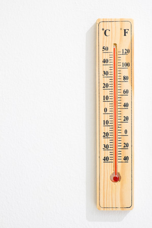Wooden Thermometer with maximum temperature  Global warming concept photo