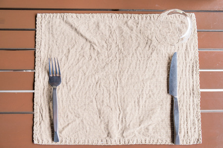 Knife, fork and glass on place mat photo
