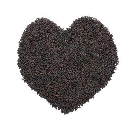 Heart shape from black sesame seed isolated on white Standard-Bild