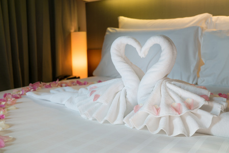 double bed: Bedroom interior design with couple swans from the towel decorate on white bed