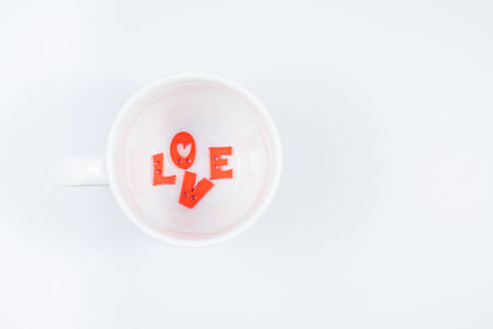 valentine day cup of coffee: LOVE Letters in White Coffee Cup (Top View) for Valentine Stock Photo