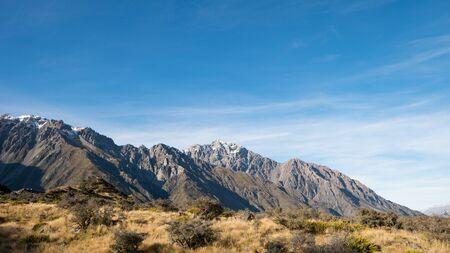 Mountain Range and Meadow at Tasman Valley Walk Track, Aoraki, New Zealand
