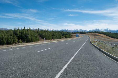 Road to Aoraki Mount Cook with mountain range backdrop, South Island, New Zealand