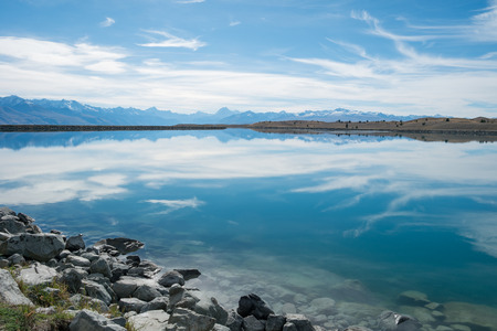 south island new zealand: Blue Lake with Mount Cook Backdrop on Cloudy day, South Island, New Zealand Stock Photo