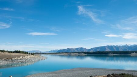 Blue Lake with Mountain Range and Blue Sky in South Island, New Zealand