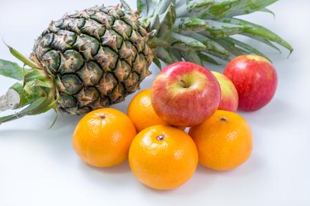 Fresh Apple Orange Pineapple Fruit on white table
