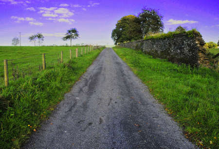Road going off into distance against a vivid sky Stock Photo - 3814881
