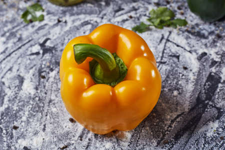 Red green yellow pepper in the kitchen black beautiful background Stock Photo