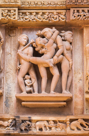 madhya pradesh: Cultural heritage of India - the sculptures made of sandstone, being couple in one of Kama-Sutra poses, on a wall of the temple of Kandariya-Mahadeva, Khajuraho, the Province of Madhya Pradesh.