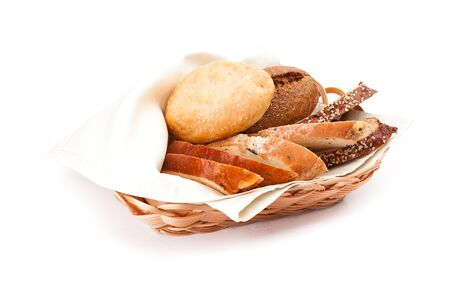 Newly-baked bun with sesame, piece of of white and black bread in a basket. Isolated on white background.