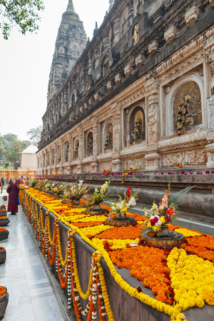 Garlands with flowers and festive bouquets at Mahabodhi Temple, in commemoration of day of an enlightenment of Buddha Shakyamuni and Buddhist New Year. Editorial
