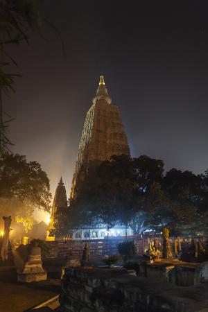 gautama: Night illumination of a Bodkhi-tree near base of Mahabodhi Temple, on the place where Buddha Shakyamuni has reached an enlightenment.