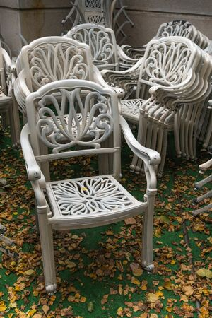 relocated: Has come autumn and garden furniture - tables, chairs and armchairs, have relocated from penthouse of restaurant on the backyard.