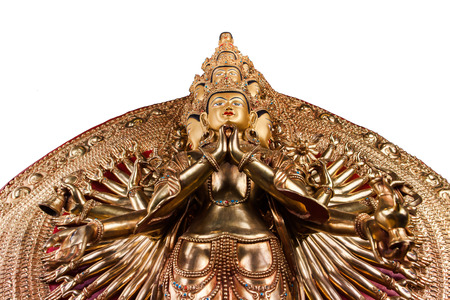 With thousand arms a bodkhisattva of an Avalokiteshvara - The statue made of bronze isolated on a white background.