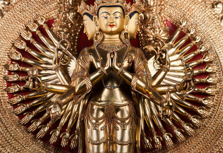 With thousand arms a bodkhisattva of an avalokiteshvara - The statue made of bronze.
