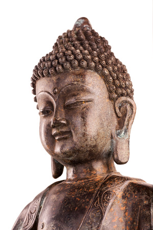 Buddha Shakyamunis figure in a manual pose - vitarka mudra. The old statue made of metal isolated on a white background. Stock Photo