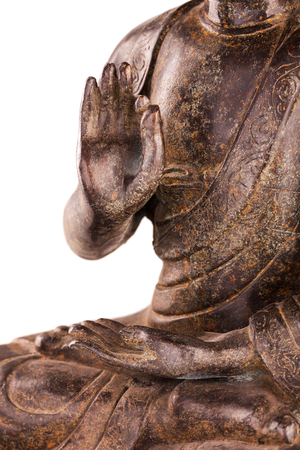 tantra: Buddha Shakyamunis figure in a manual pose - vitarka mudra. The old statue made of metal isolated on a white background. Stock Photo