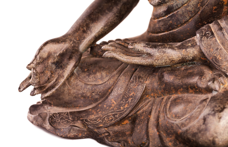 tantra: Buddha Shakyamunis figure in a blessing pose - varada mudra. The old statue made of metal isolated on a white background.