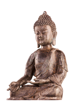 Buddha Shakyamunis figure in a blessing pose - varada mudra. The old statue made of metal isolated on a white background.