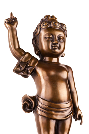 Young prince Siddhartha Gautama. The figure made of metal isolated on a white background.