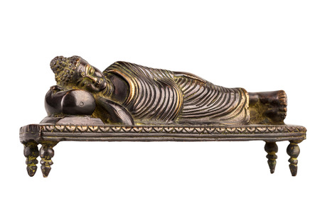 Buddha in parinirvana position - a figure from bronze, isolated on a white background.
