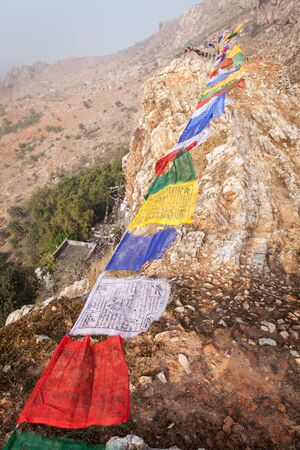 gautama: Lungta (horse of wind) - the Tibetan prayful flags, over a mountain ridge with Mahakalas cave, the place where the prince, and then the ascetic Siddhartha Gautama have spent some time in an ascesis.