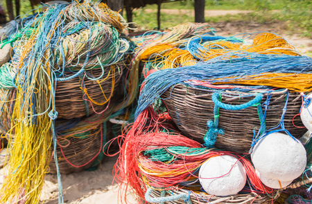 Color fishing net, floats, nylon rope used in fishing industry in on the beach in fishing small village.