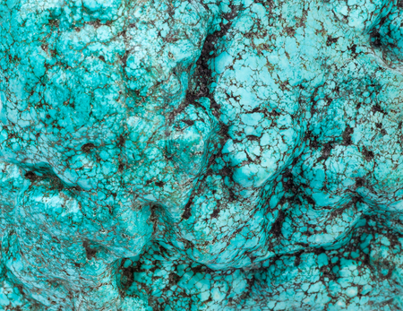 The big piece of a natural stone of turquoise like a background or wallpaper.