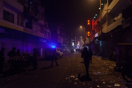 The police patrol is on duty in the poor mans criminal blighted area along Main Bazar Street, Delhi, India. January 26, 2014.