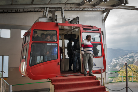 The red cabin of the ropeway in the capital of the Indian state of Sikkim, waits for the departure. Gangtok, India, on January 6, 2018