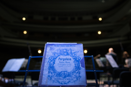 Old music book with notes of the cantata of Stabat Mater of the Italian composer of Pergolese on the stage of the Kharkiv Opera Theatre. Ukraine, Kharkiv, KHNATOB, on April 25, 2018 Editorial