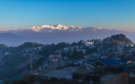 View of the mountain ridge of Kanchendzhonga in the State of Sikkim, from the district of the city of Darjeeling, early in the morning, in beams of a rising sun.