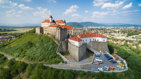 Aerial view on the ancient castle of Palanok and the foothills of Carpathians Mountains, in Mukachevo, the Transcarpathian region of Ukraine.