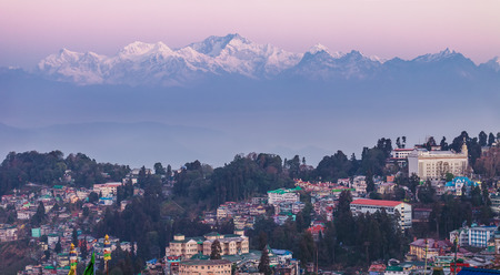 View of a mountain ridge of Kanchendzhonga in the State of Sikkim, from the neighborhood of the city of Darjeeling, early in the morning, till the sunrise. Stock Photo
