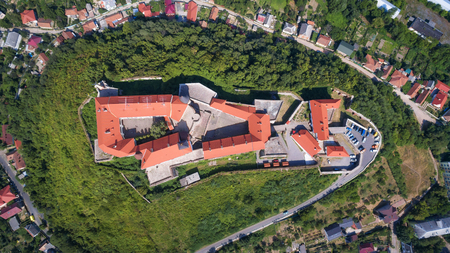 Aerial top view on the ancient castle of Palanok and the foothills of Carpathians Mountains, in Mukachevo, the Transcarpathian region of Ukraine.