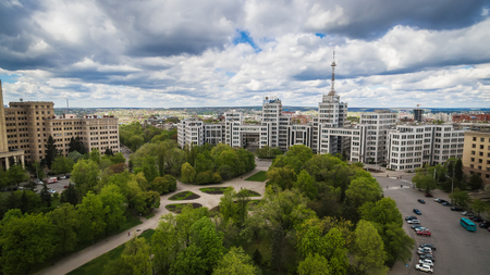 The aerial view in cloudy day, on the central part of the Ukrainian city of Kharkiv, with a historical complex of the buildings called Gosprom which is an architecture monument in style of constructivism.