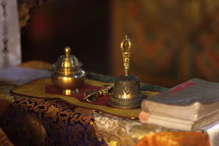 Ritual hand bell and dorje in the Buddhist temple as the enlightenment symbol.