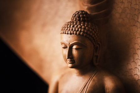 Buddha in a meditation pose, under protection of the king of nag - Mukalinda. Figure isolated on a black background. Stock Photo