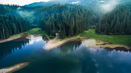 Aerial view on heart of Ukrainian part of Carpathians Mountains - the lake Synevyr.
