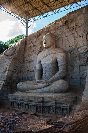 The stone image of Buddha Gautama in dhyana mudra, located in Gal Vihara of the area in the neighborhood of the ancient capital of Sri Lanka - the city of Polonnaruwa.
