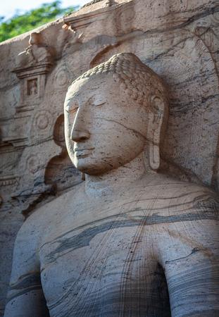 The closeup of stone image of Buddha Gautama in dhyana mudra, located in Gal Vihara, near of Polonnaruwa - ancient capital of Sri Lanka.