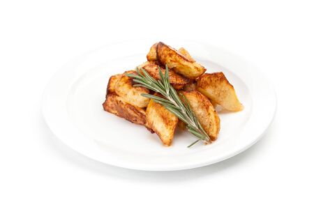 Oven-baked potato wedges with a sprig of rosemary served on a white dish. Image for the menu of restaurants and cafes isolated on a white background.
