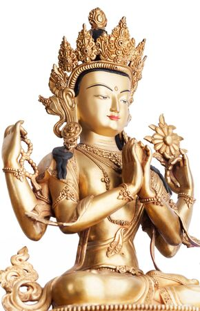 The gilded four-armed form of Avalokiteshvara made of metal isolated on white background. Executed in the Tibetan tradition. Reklamní fotografie