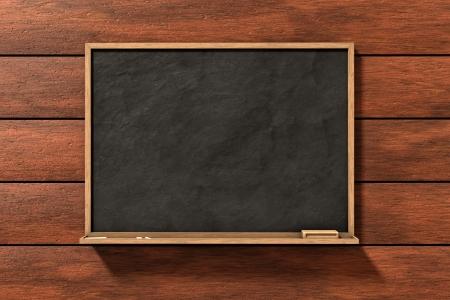 Blackboard op bruine houten achtergrond Stockfoto