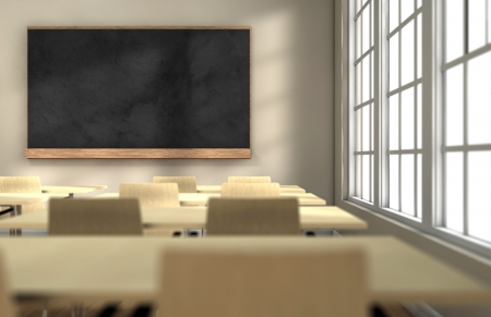 school table: Classroom with desks and blackboard with focus on the blackboard Stock Photo