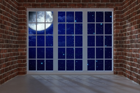 Room with a large window at night photo
