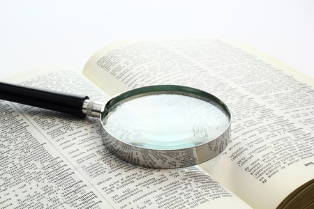 Magnification glass over a opened book photo