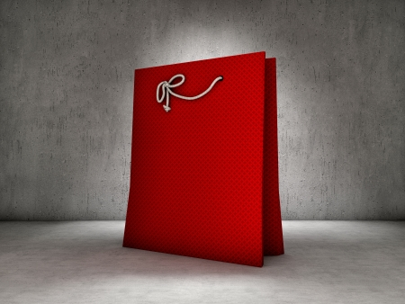 Red shopping bag on concrete background photo